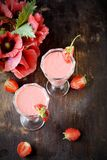 Two glasses of strawberry cocktail Stock Image