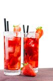 Two glasses of strawberry cocktail with ice and strawberry on top Royalty Free Stock Image