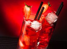 Two glasses of  strawberry cocktail with ice on wood table Royalty Free Stock Images