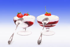 Two glasses of a strawberry dessert with cream Royalty Free Stock Photos