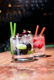 Two glasses of strawberry and grape mojitoes. On marble table Stock Photography