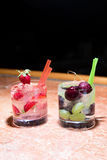 Two glasses of strawberry and grape mojitoes. On marble table Royalty Free Stock Photography