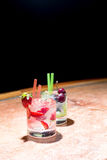 Two glasses of strawberry and grape mojitoes. On marble table Royalty Free Stock Images