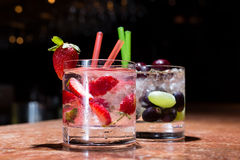 Two glasses of strawberry and grape mojitoes. On marble table Royalty Free Stock Photos