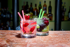 Two glasses of strawberry and grape mojitoes. On marble table Stock Photo