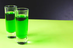 Two glasses of sweet alcoholic green liqueur Stock Photos