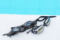 Two Glasses for swimming black on pool edge Stock Images