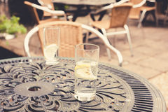 Two glasses on a table in garden Stock Images