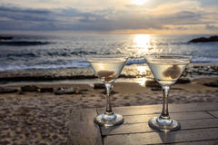 Two glasses on a table at sunset view cafe, Sunset Point, Nusa Lembongan, Indonesia. Two glasses on a table at sunset view cafe, at Sunset Point, Nusa Lembongan Royalty Free Stock Image