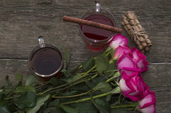 Two glasses of tea and bouquet of a rose, top view Royalty Free Stock Photography