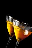 Two glasses tilted of fresh cocktail with ice Royalty Free Stock Images