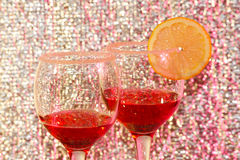 Two glasses of transparent red liquor and lemon. The two glasses of transparent red liquor and lemon Royalty Free Stock Image
