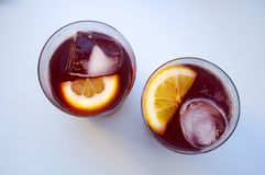 Two glasses with vine cocktail, lemon, ice, top view royalty free stock images