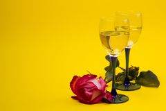 Two glasses with vine and  roses Royalty Free Stock Photography