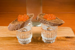 Two   glasses of vodka and   sandwich Royalty Free Stock Photo