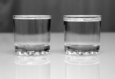 Two glasses with vodka on table Stock Photography