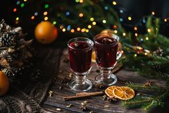 Two glasses of warm mulled wine on a decorated Christmas wooden table stock images