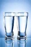 Two glasses of water on a blue Stock Photography