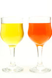 Two glasses of water color with yellow and orange. On white background Royalty Free Stock Images