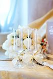 Two glasses and wedding flowers Stock Images