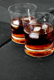 Two glasses of whiskey. With ice or on the rocks Royalty Free Stock Photography