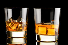 Two glasses of whiskey with ice Stock Photo