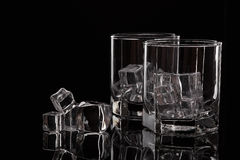 Two glasses for whiskey with ice. Royalty Free Stock Photo