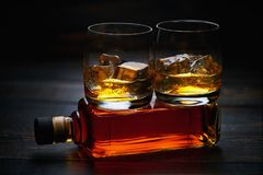 Two glasses of whiskey  with ice   . horizontal composition Royalty Free Stock Image