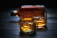 Two glasses of whiskey  with ice   . horizontal composition Stock Photos