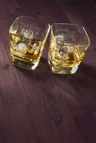 Two glasses of whiskey on old background Stock Photo