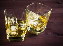 Two glasses of whiskey on old wood table Royalty Free Stock Image