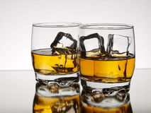 Two glasses of whiskey on the rocks Stock Photography