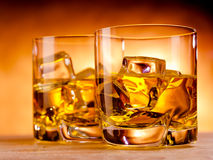 Two whiskeys and a bottle Royalty Free Stock Photos