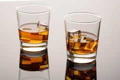 Two glasses of whiskey on the rocks Royalty Free Stock Photography