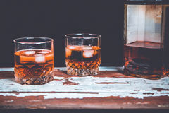 Two glasses of whiskey standing on the bar Royalty Free Stock Images