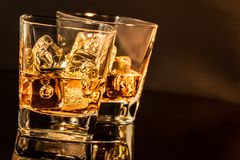 Two glasses of whiskey, warm atmosphere Royalty Free Stock Photography