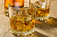 Two glasses of whisky and a bottle Stock Photography