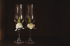 Two glasses. With white flowers Stock Photos