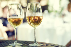 Two glasses of white whine outdoors Royalty Free Stock Images