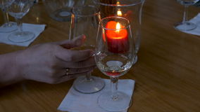 Two glasses of white wine on the background of candles stock video footage