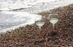 Two glasses of white wine on the beach Royalty Free Stock Photo