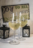 Two glasses of white wine on a light wooden table in cafe of Cordoba, Spain Royalty Free Stock Photo