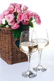 Two glasses of white wine and roses Royalty Free Stock Image