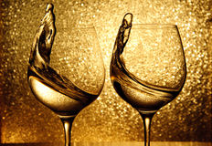 Two glasses of white wine splashing royalty free stock photos