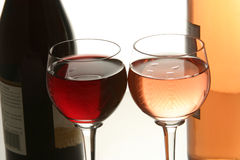 Two glasses of wine. With the bottles in the background Stock Photo