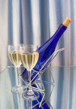 Two glasses of wine. And blue bottle Stock Photography