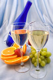 Two glasses of wine. With oranges and grapes Royalty Free Stock Image