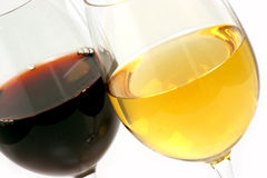Two glasses of wine. Two different glasses of wine one white Chardonnay and one red Cabernet Sauvignon Stock Photos