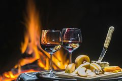 Two glasses of wine on the background of fire Stock Photography