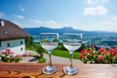 Two glasses of wine in austrian mountain outdoors Stock Photography